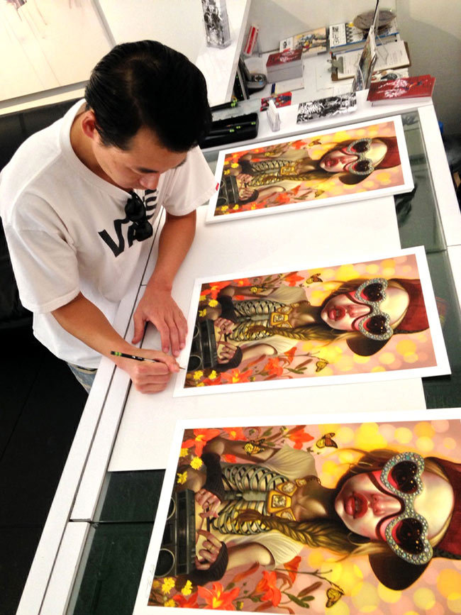 Young Chun - Aritst Signing Prints (Photo Courtesy of CAVE Gallery)